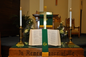 Bible and cross on the communion table